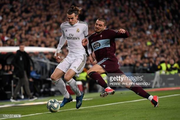 Celta Vigo's Turkish midfielder Okay Yokuslu challenges Real Madrid's Welsh forward Gareth Bale during the Spanish league football match between Real...