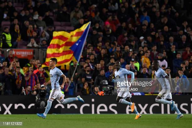 Celta Vigo's Uruguayan defender Lucas Olaza celebrates after scoring during the Spanish league football match between FC Barcelona and RC Celta de...