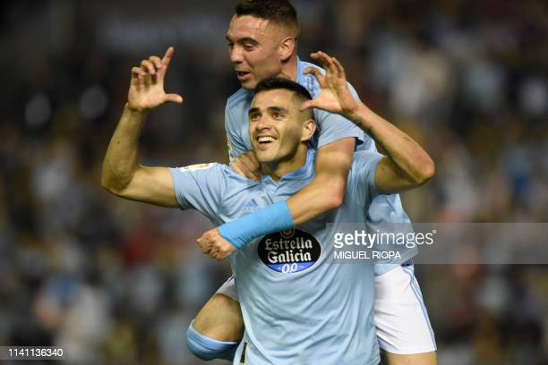 Celta Vigo's Uruguayan forward Maxi Gomez celebrates his goal with teammate Spanish forward Iago Aspas during the Spanish league football match...