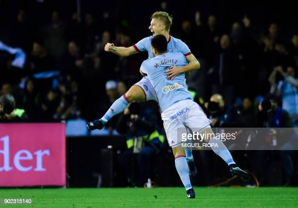 Celta Vigo's Uruguayan forward Maxi Gomez celebrates with Danish midfielder Daniel Wass after scoring a goal during the Spanish league football match...