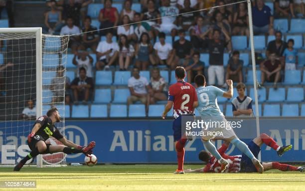 Celta Vigo's Uruguayan forward Maxi Gomez shoots to score a goal during the Spanish league football match between RC Celta de Vigo and Club Atletico...