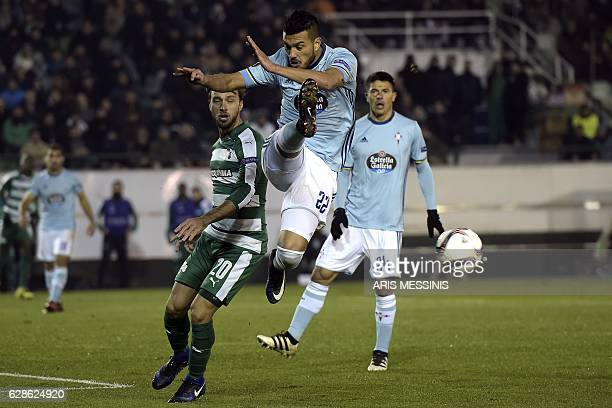 Celta's Argentinian defender Gustavo Cabral shoots the ball as Panathinaikos' Argentinian forward Lautaro Rinaldi stands behind him during the UEFA...