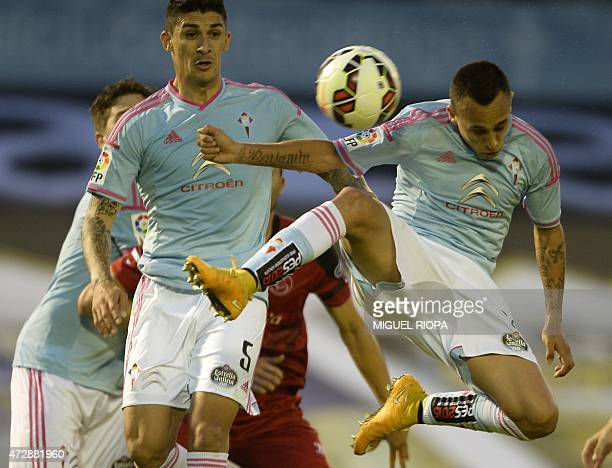 Celta's Chilean forward Fabian Orellana tries to control the ball next to his teammate Chilean midfielder Pablo Hernandez during the Spanish league...