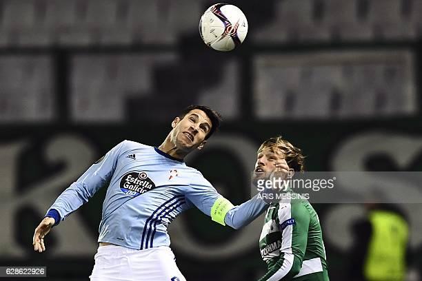 Celta's Spanish defender Hugo Mallo heads the ball next to Panathinaikos' Argentinian forward Lautaro Rinaldi during the UEFA Europa League group...