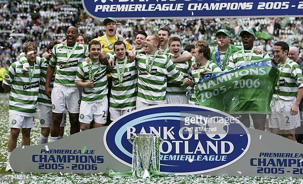 Celtic are seen celebrating with the Scottish Premier division trophy after the match between Celtic and Hibernian at Celtic Park April 16Glasgow in...