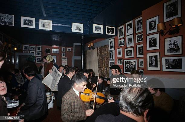 A Celtic band is playing live music in O'Domoghue's Pub in Dublin significant site located near St Stephen's Green the band is composed of the violin...