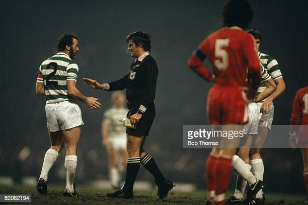 Celtic captain Danny McGrain is spoken to by referee Agnolin after a bottle was thrown from the terraces during the European Cup Winners Cup 2nd...