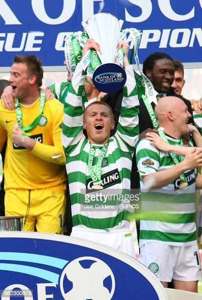 Celtic captain Neil Lennon lifts the Bank of Scotland Premier Division trophy