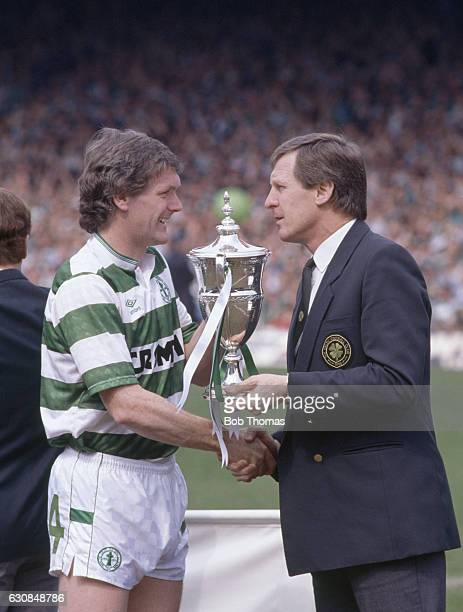 Celtic captain Ray Aitken with his manager Billy McNeill and the Scottish Premier Division Championship trophy following their 10 victory over...
