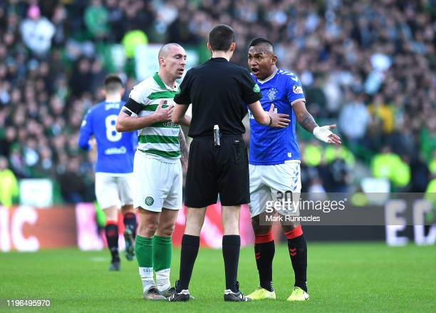 Celtic captain Scott Brown and Alfredo Morelos of Rangers clash during the Ladbrokes Premiership match between Celtic and Rangers at Celtic Park on...