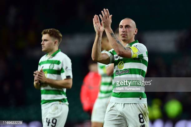 Celtic Captain Scott Brown applauds fans at the final whistle of the UEFA Europa League Play Off First Leg match between Celtic and AIK at Celtic...