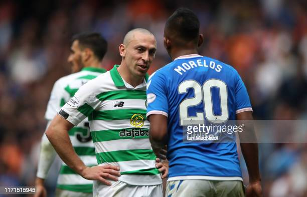 Celtic captain Scott Brown interacts with Alfredo Morelos of Rangers during the Ladbrokes Premiership match between Rangers and Celtic at Ibrox...