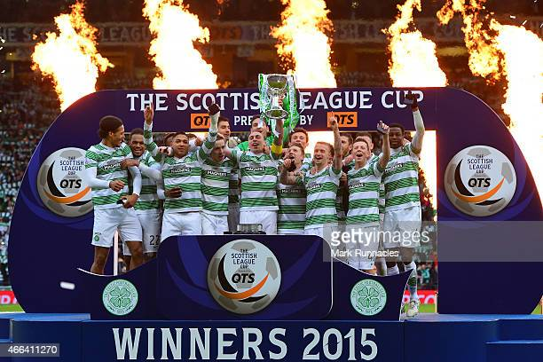 Celtic captain Scott Brown lifts the League Cup trophy as the Celtic team celebrate winning the Scottish League Cup Final between Dundee United and...