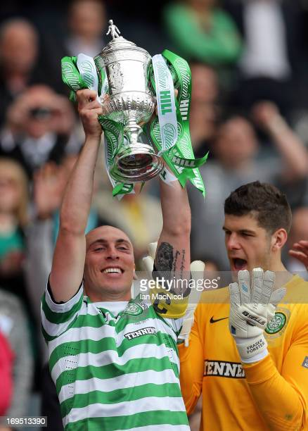 Celtic captain Scott Brown lifts the trophy after defeating Hibernian 30 in the William Hill Scottish Cup Final match at Hampden Stadium on May 26...