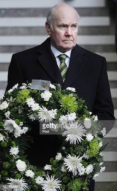 Celtic Chairman John Reid holds a wreath attend the service to commemorate the 40th Anniversary Memorial of the Ibrox Disaster held at the Ibrox...