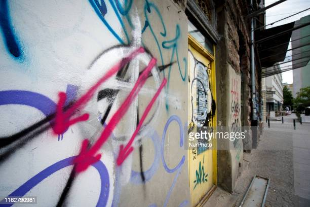 A Celtic cross is seen painted on a house in the former Warsaw Ghetto on August 7 2019 in Warsaw Poland The Celtic cross is often used to symbolise...