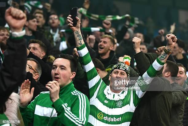 Celtic fan cheers his team during the UEFA Champions League Group C match between Manchester City FC and Celtic FC at Etihad Stadium on December 6...