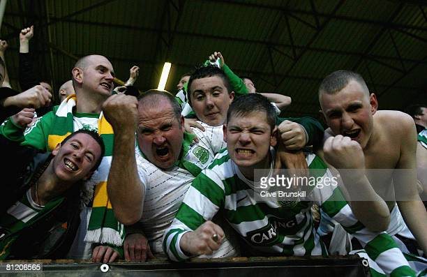 Celtic fans celebrate after Jan Vennegoor of Hesselink of Celtic scored the first goal during the Clydesdale Bank Premier League match between Dundee...