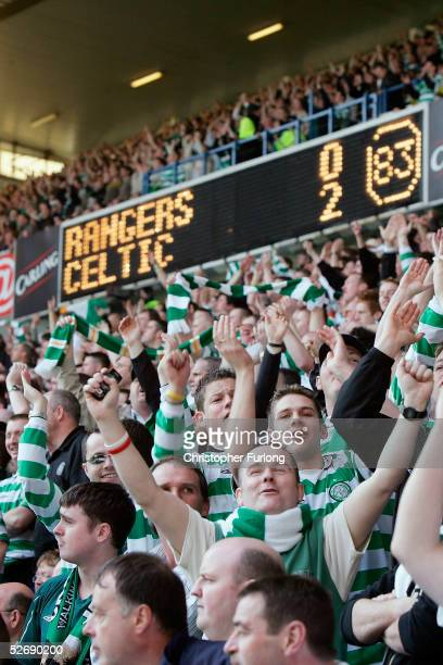 Celtic fans celebrate beating Rangers 02 during the infamous 'Old Firm Game' in the Scottish Premier League between Glasgow Rangers and Celtic at...