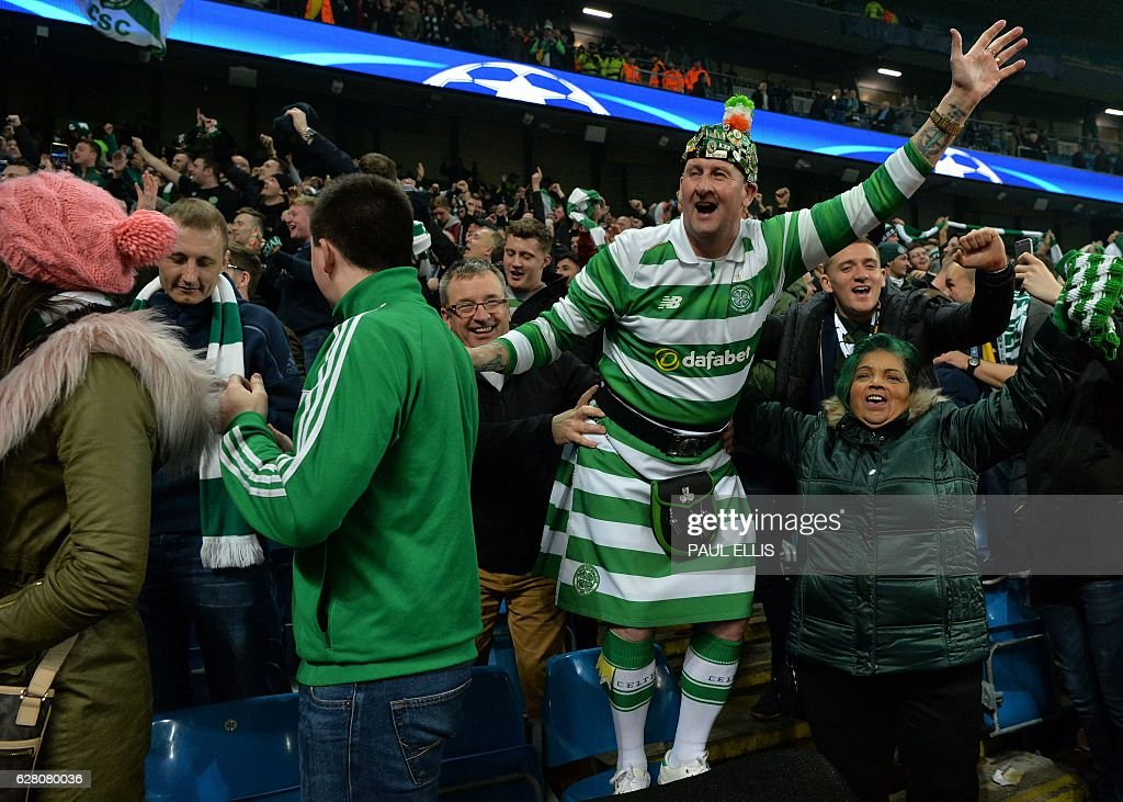Celtic fans celebrate following the UEFA Champions League group C football match between Manchester City and Celtic at the Etihad Stadium in Manchester, northern England, on December 6, 2016. The match ended in a draw at 1-1. / AFP / Paul ELLIS