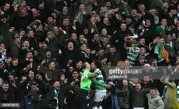 Celtic fans celebrate the winning goal of Scott Sinclair of Celtic during the Rangers v Celtic Ladbrokes Scottish Premiership match at Ibrox Stadium...