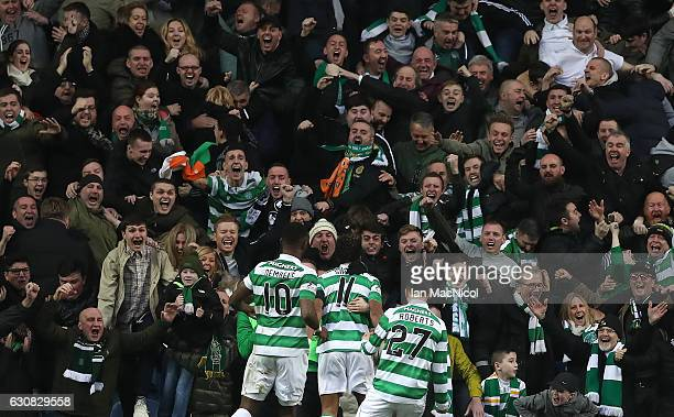 Celtic fans celebrate the winning goal of Scott Sinclair of Celtic during the Rangers v Celtic Ladbrokes Scottish Premiership match at Ibrox Stadium...