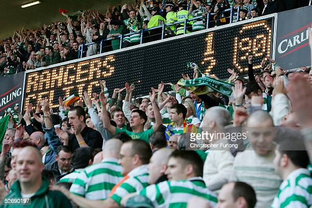 Celtic fans celebrate their 12 win over Rangers at the end of the infamous 'Old Firm Game' in the Scottish Premier League between Glasgow Rangers and...