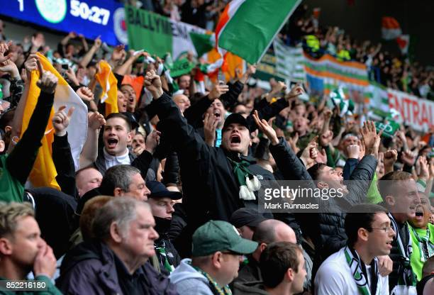 Celtic fans celebrate their sides first goal during the Ladbrokes Scottish Premiership match between Rangers and Celtic at Ibrox Stadium on September...