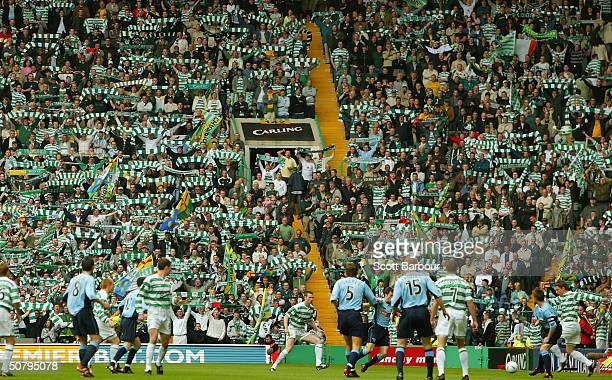 Celtic fans cheer during the Scottish Premier League match between Glasgow Celtic and Dunfermline Athletic played at Celtic Park on May 2, 2004 in...