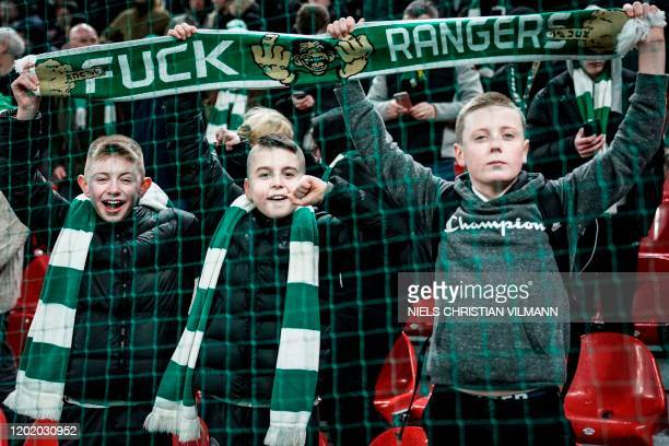 Celtic fans cheer prior to the Europa League last 32 first leg football match between FC Copenhagen and Celtic in Copenhagen on February 20 2020 /...