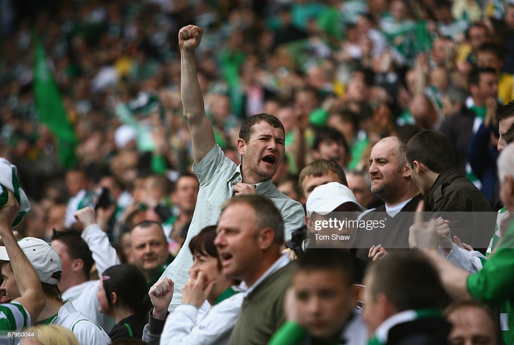 Celtic fans cheers on their team during the Scottish Premier League match between Celtic and Hearts at Parkhead on May 24, 2009 in Glasgow, Scotland.