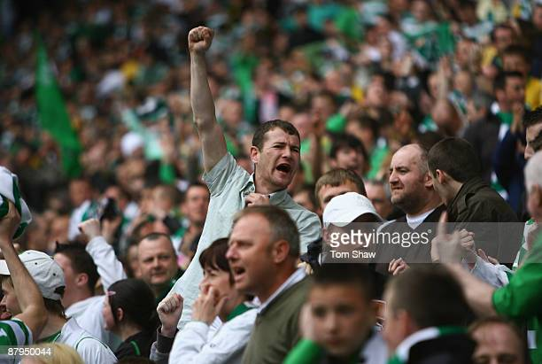 Celtic fans cheers on their team during the Scottish Premier League match between Celtic and Hearts at Parkhead on May 24 2009 in Glasgow Scotland