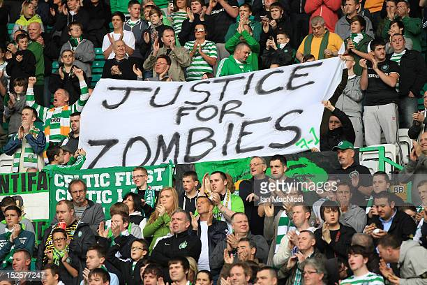 Celtic fans display a banner during the Clydesdale Bank Scottish Premier League match between Celtic and Dundee on September 22 2012 in Glasgow...