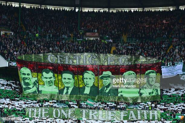 Celtic fans display a banner for former Celtic legends prior to the Ladbrokes Scottish Premiership match between Celtic and Rangers at Celtic Park on...