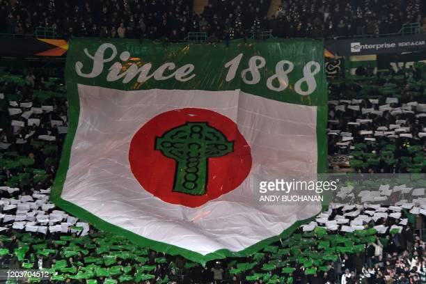 Celtic fans display a large banner in the crowd ahead of the UEFA Europa League round of 32 second leg football match between Celtic and Copenhagen...