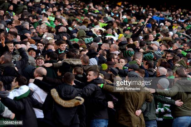 Celtic fans do the Poznan during the Betfred Scottish League Cup Semi Final between Heart of Midlothian FC and Celtic FC on October 28 2018 in...