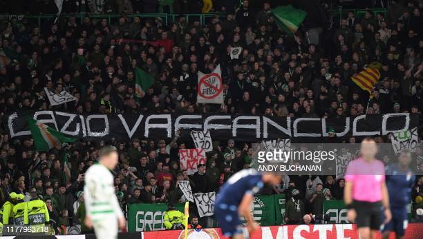 Celtic fans hold offensive banners during the UEFA Europa League group E football match between Celtic and Lazio at Celtic Park stadium in Glasgow...