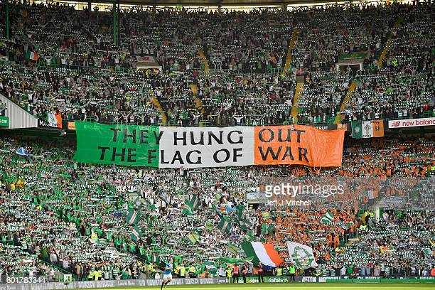 Celtic fans hold up a banner during the Ladbrokes Scottish Premier league match between Celtic and Rangers at Celtic Park Stadium on September 10...