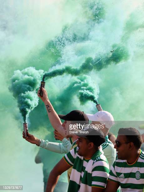 Celtic fans light smoke flares ahead of the UEFA Champions League Second Qualifying Round First Leg between Celtic and FC Midtjylland at Celtic Park...