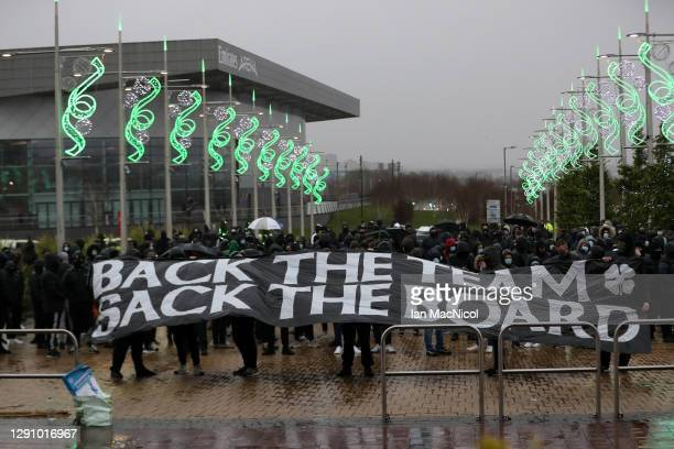 Celtic fans protest holding up a banner outside the stadium prior to the Ladbrokes Scottish Premiership match between Celtic and Kilmarnock at Celtic...