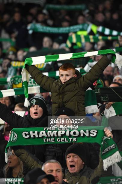 Celtic fans raise their scarves in the crowd ahead of the UEFA Europa League group E football match between Celtic and Rennes at Celtic Park stadium...