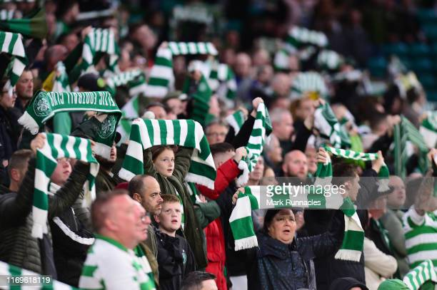 Celtic fans show their colours during the UEFA Europa League Play Off First Leg match between Celtic and AIK at Celtic Park on August 22 2019 in...