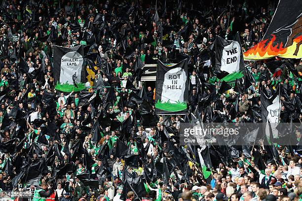 Celtic fans taunt the Rangers fans with their display of black flags and banners prior to the Clydesdale Bank Premier League match between Celtic and...