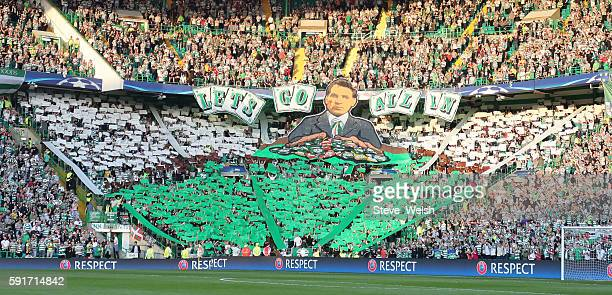 Celtic fans unveil a large picture of Celtic Manager Brendan Rodgers during the UEFA Champions League Qualifying PlayOff 1st Leg between Celtic and...