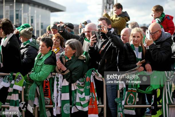 Celtic fans wait for the team to arrive at the stadium before the Ladbrokes Scottish Premiership match at Celtic Park Glasgow