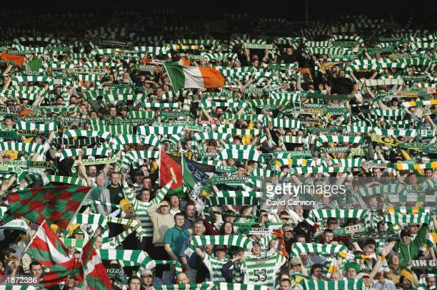 Celtic fans waving their scarves during the CIS Insurance Cup Final match between Celtic and Glasgow Rangers held on March 16, 2003 at Hampden Park...