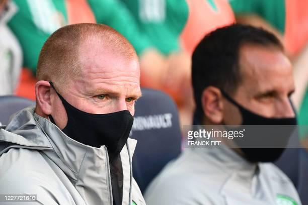 Celtic FC's Irish head coach Neil Lennon wearing a protective face mask looks on during the friendly football match Paris SaintGermain vs Glasgow...