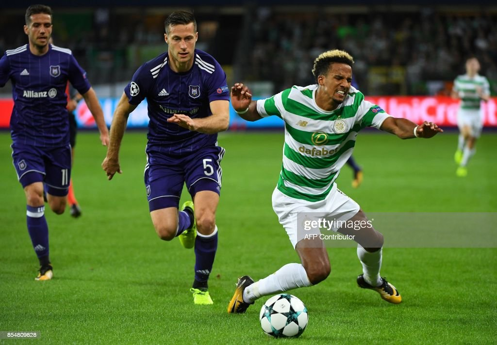 Celtic FC's Scott Sinclair (R) fights for the ball with RSC Anderlecht's Uros Spajic during the UEFA Champions League Group B football match Anderlecht vs Celtic at The Constant Vanden Stock Stadium in Brussels on September 27, 2017. /