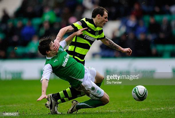 Celtic forward Anthony Stokes is brought down by Hibernian defender Lewis Stevenson to concede a penalty during the Clydesdale Bank Premier League...