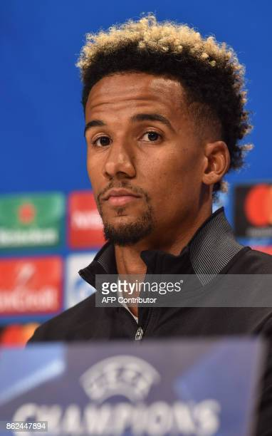 Celtic Glasgow's midfielder Scott Sinclair follows the press conference on the eve of the Champions League group B match between Bayern Munich and...